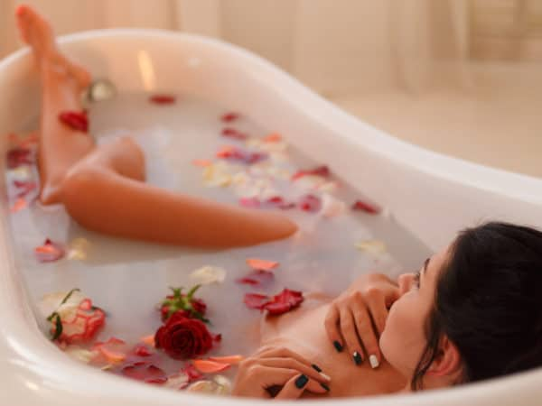 attractive-girl-takes-a-bath-with-milk-and-rose-pe-PSZ3DYU